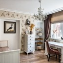 3-neo-classical-style-interior-design-in-beige-brown-and-white-kid's-toddler-girl's-room-floral-wallpaper-writing-desk-with-two-cabinets-folding-couch-sofa-wall-chest-of-drawers-wrought-whatnot-wall-recess-bird-laminate
