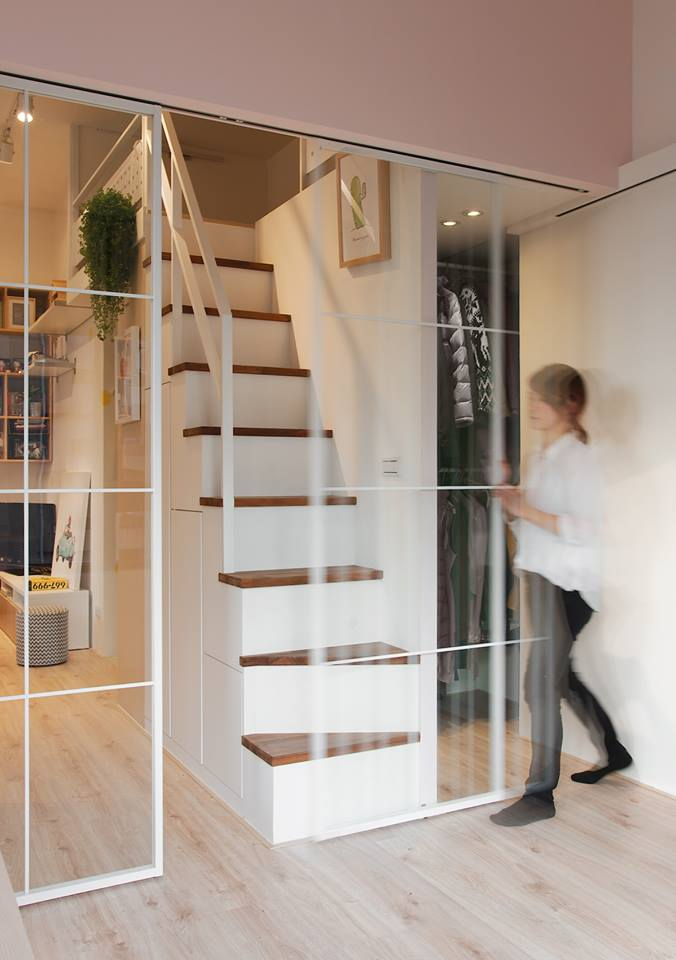 4-2-interior-by-A-Lentil-Design-Taiwan-China-white-walls-light-laminate-sliding-doors-attic-mezzanine-loft-room-staircase-glass-wall-walk-in-closet-young-woman