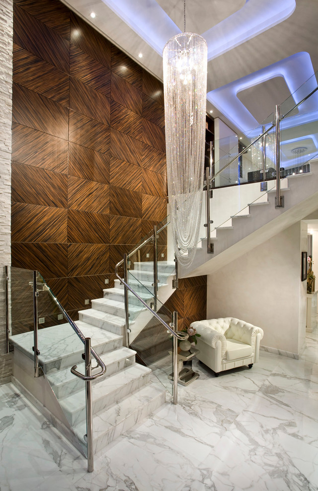4-4-stone-staircase-stairs-white-marble-contemporary-style-wooden-wall-panels-decor-arm-chair-big-chandelier