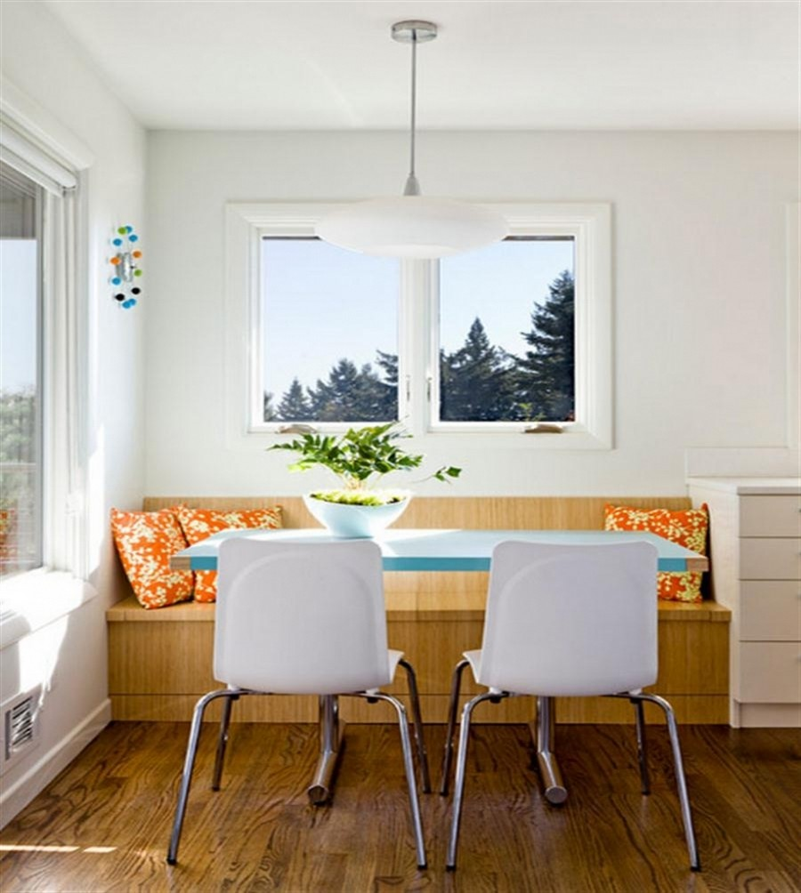 4-dining-room-area-interior-design-ideas-built-in-kitchen-bench-wooden-throw-pillows-tradtional-style-light-room-white-walls-blue-table-white-chairs-with-storage-beneath