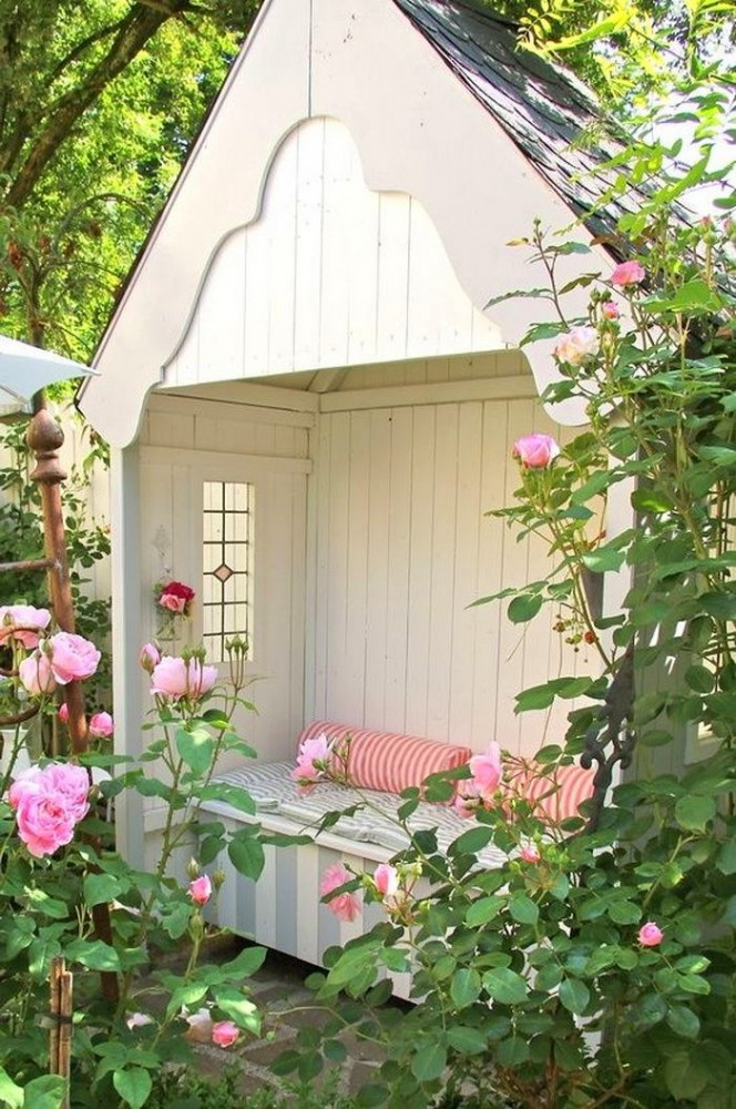 6-wooden-hut-reading-nook-bench-seat-in-the-garden-pink-roses-blossom