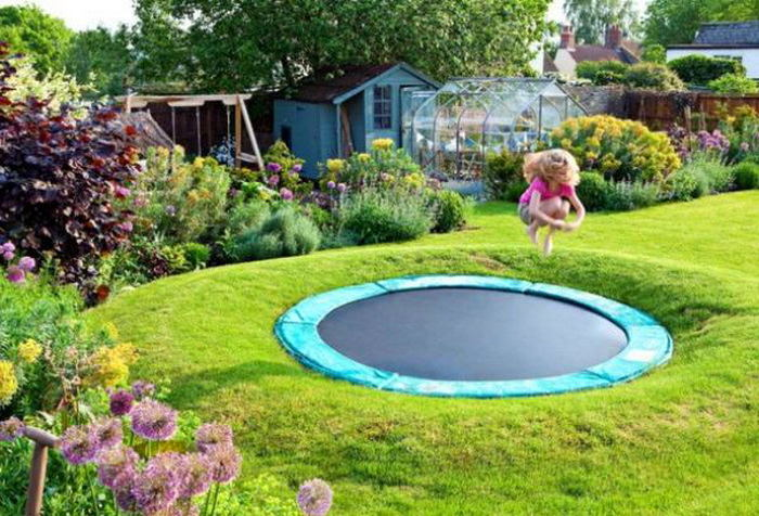 8-sunken-dug-in-ground-trampoline-little-girl-jumping-outdoor