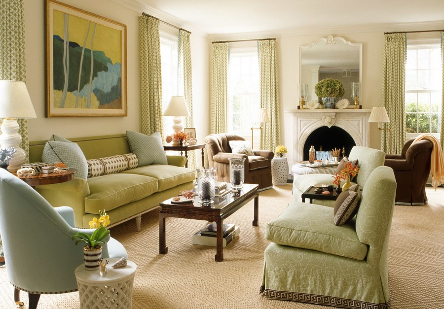 9-American-style-living-room-set-mismatched-arm-chairs-light-green-blue-beige-light-pastel-colors-cozy-sofa-table-lamps-fireplace-mirror-slip-covers-carpeting-throw-pillows