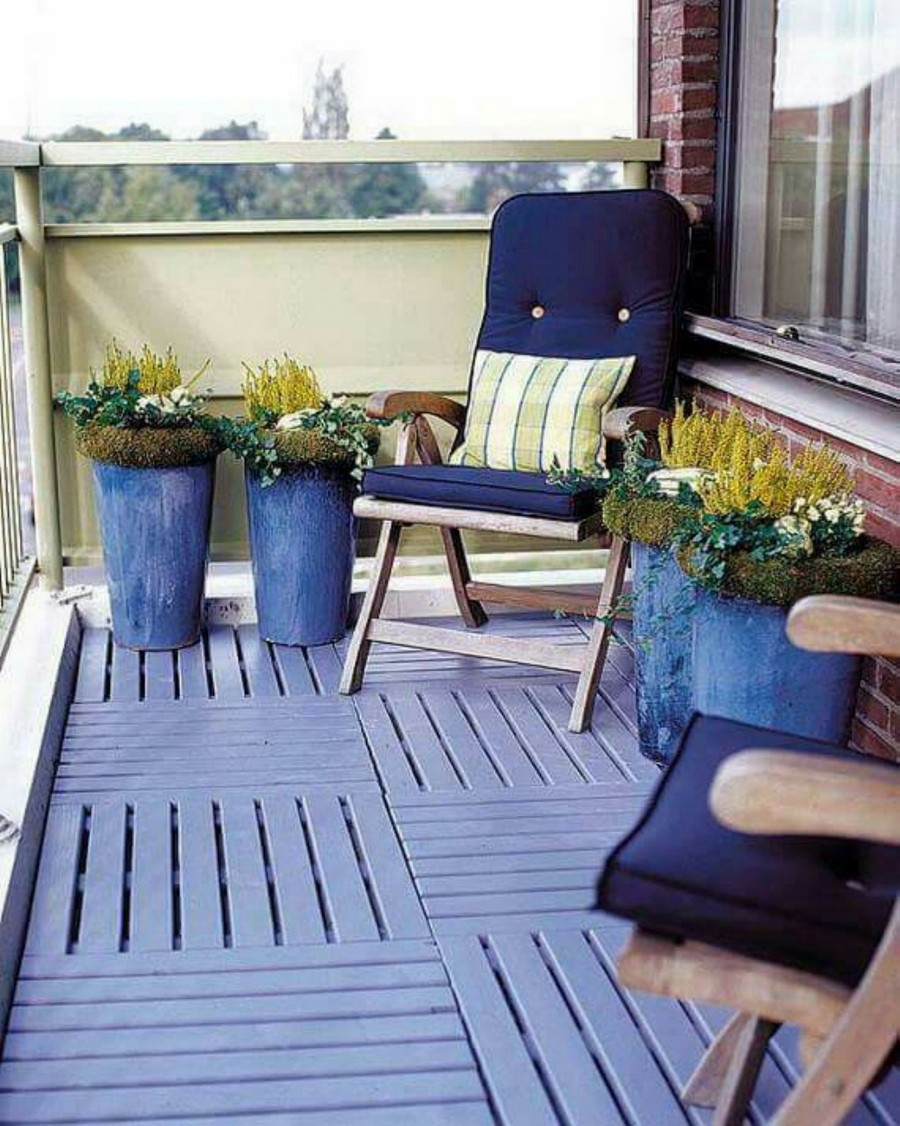 0-cozy-balcony-design-in-blue-colors-wooden-chairs-with-cushions-flower-pots-buckets-decking-floor