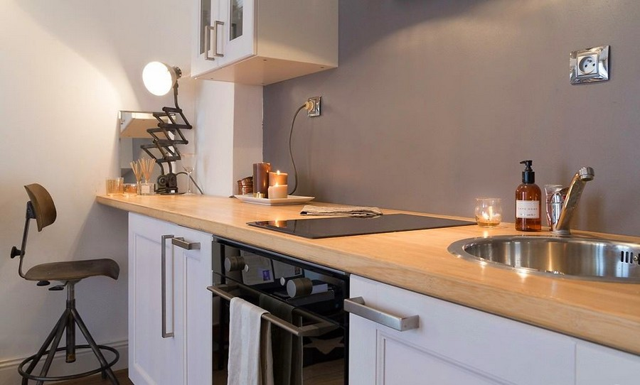1-1-white-walls-beige-gray-caramel-brown-interior-design-in-French-style-Paris-kitchen-wooden-worktop-black-lamp-sink-oven-painted-backsplash-tray-candles