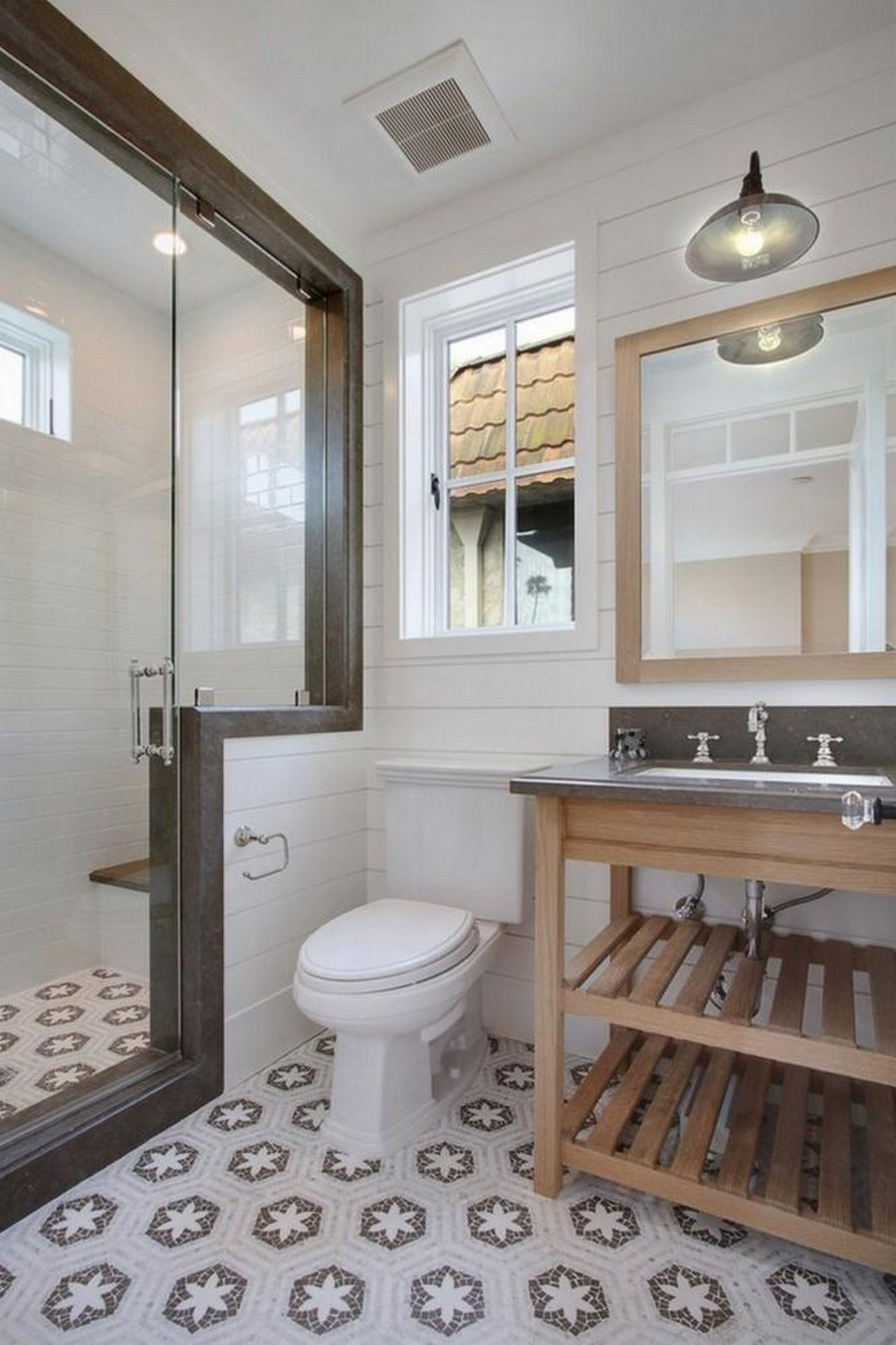 1-clean-tidy-neat-traditiobal-style-bathroom-interior-design-light-wooden-vanity-unit-wooden-planks-mirror-frame-white-walls-glass-walk-in-shower-WC-toilet-window-extraction-fan-hexagonal-floor-tiles-light