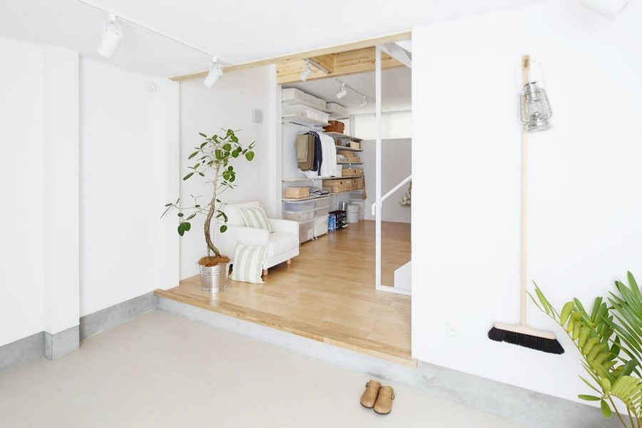 1-minimalist-style-interior-white-walls-light-wood-floor-furniture-Scandinavian-style-pantry-walk-in-closet-storage-area-lantern-mop-indoor-plant-in-a-bucket