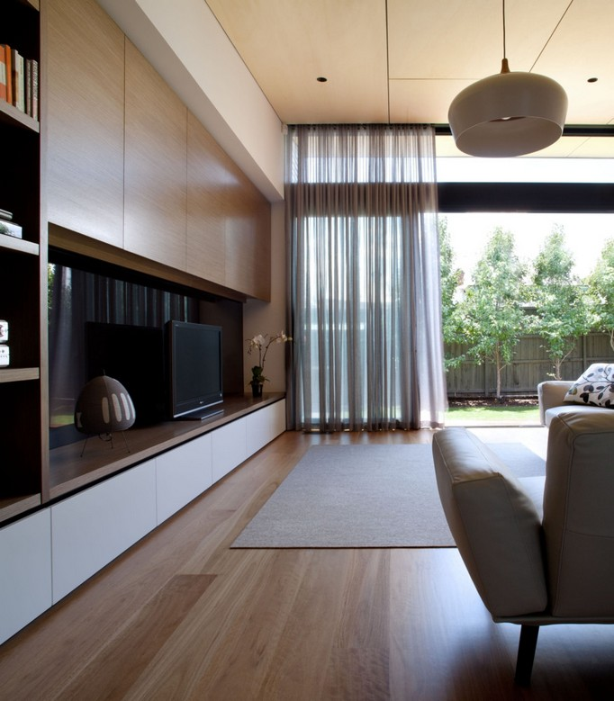 10-1-MDF-panels-boards-in-interior-design-top-cabinets-above-TV-set-panoramic-windows-curtains-arm-chair-rug-living-room