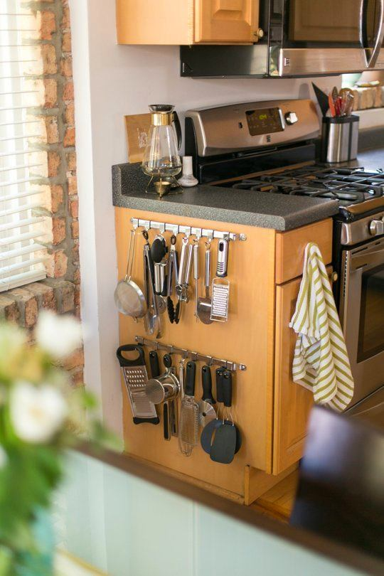 10-small-kitchen-storage-ideas-design-hacks-rational-space-rails-railings-on-side-of-cabinets-holder-for-utensils