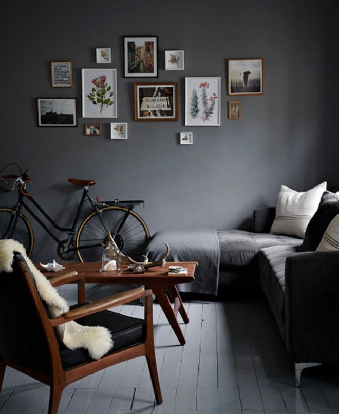 11-black-walls-black-walled-room-in-interior-design-corner-sofa-wooden-coffee-table-arm-chair-white-floor-wooden-wall-art