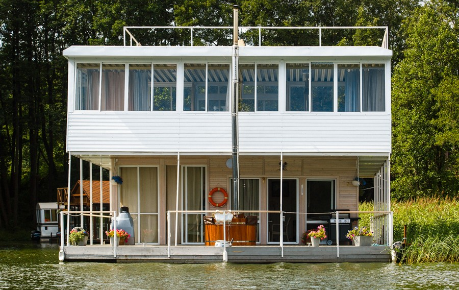 15-float-house-sailing-house-houseboat-exterior-design-flower-pots-terrace-windows-chimney-barrel-sauna