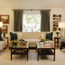 2-3-symmetrical-decor-symmetry-in-interior-design-beige-living-room-brown-curtains-blue-throw-pillows-coffee-tables-sofas-arm-chairs-lamps