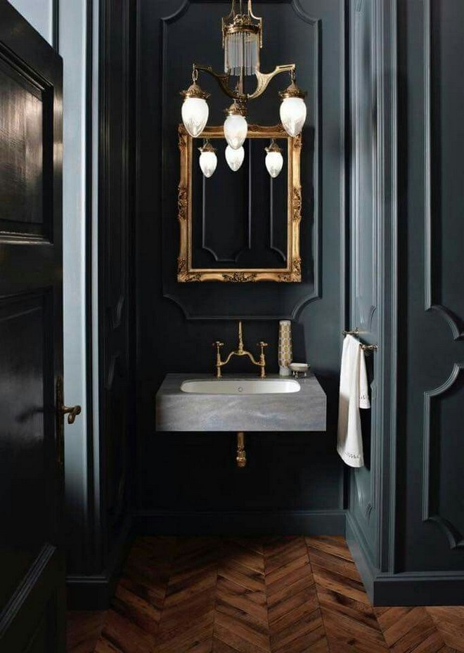 2-black-walls-black-walled-room-in-interior-design-golden-mirror-frame-stone-sink-wash-basin-WC-bathroom-herringbone-parquet-floor-pattern-wall-moldings-gothic