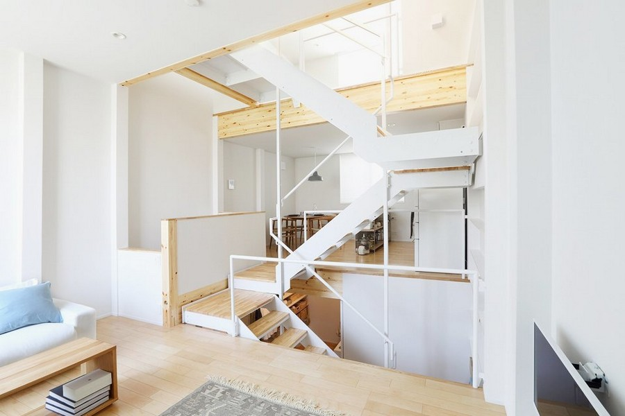 2-minimalist-style-interior-white-walls-light-wood-floor-furniture-Scandinavian-style-living-room-staircase-three-floors