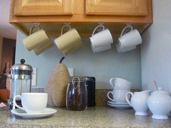 25-small-kitchen-storage-ideas-design-hacks-rational-space-tea-cups-mugs-mounted-to-bottom-cabinet-holders-hanging-on-hooks