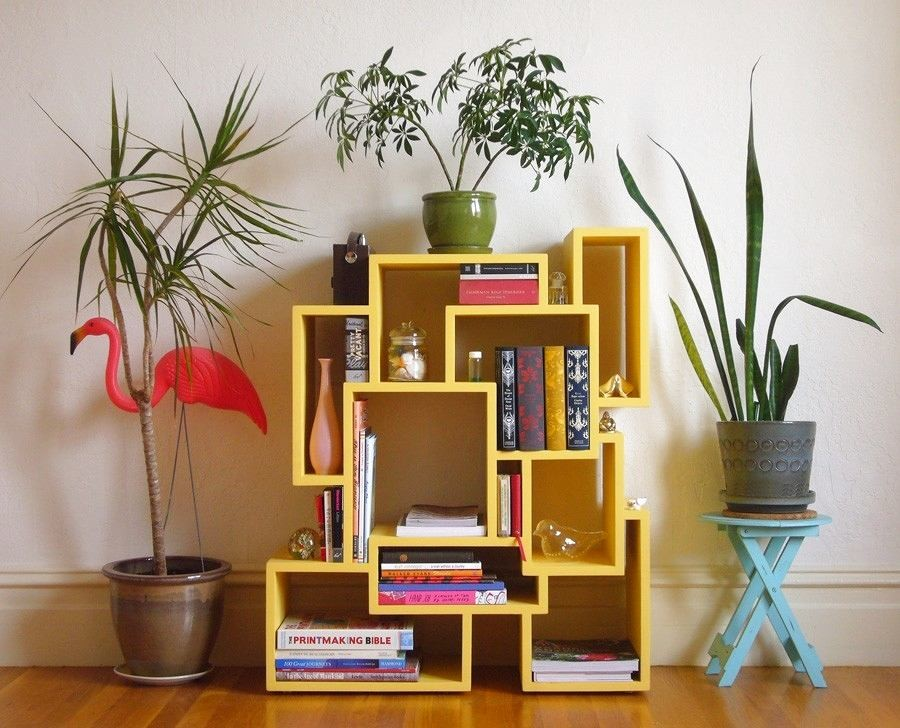 3-1-shelves-decoration-of-bookshelves-decor-ideas-yellow-geometrical-shelving-unit-asymmetricak-painted-turquoise-blue-stool-flamingo-indoor-plants