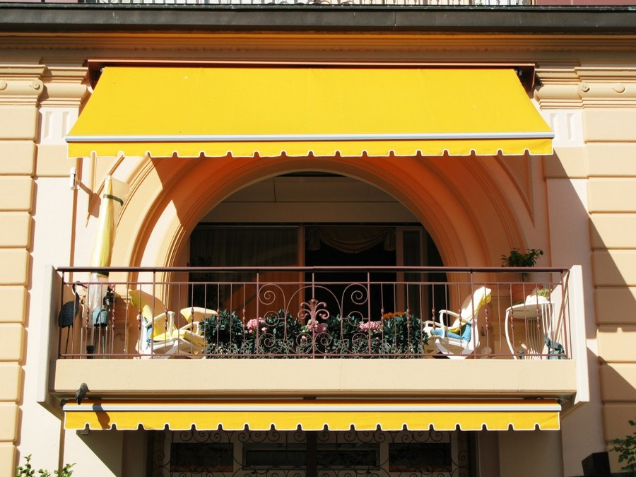 3-cozy-balcony-design-with-yellow-sunblind-forged-wrought-guardrail-railing