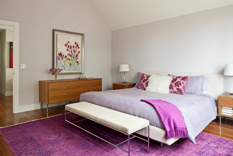 4-2-symmetrical-decor-symmetry-in-interior-design-light-gray-walls-purple-lilac-accents-bedroom-bed-console-table-nightstand-ottoman-bench-artwork