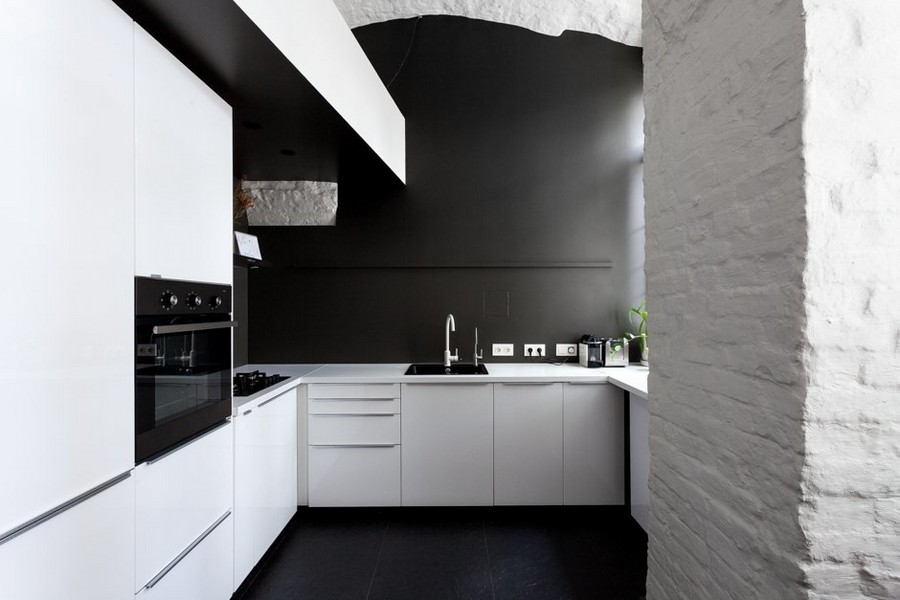 4-minimalist-style-ascetic-interior-painted-white-walls-brick-masonry-arched-ceiling-kitchen-set-by-IKEA-black-backsplash-white-cabinets-sink-built-in-oven