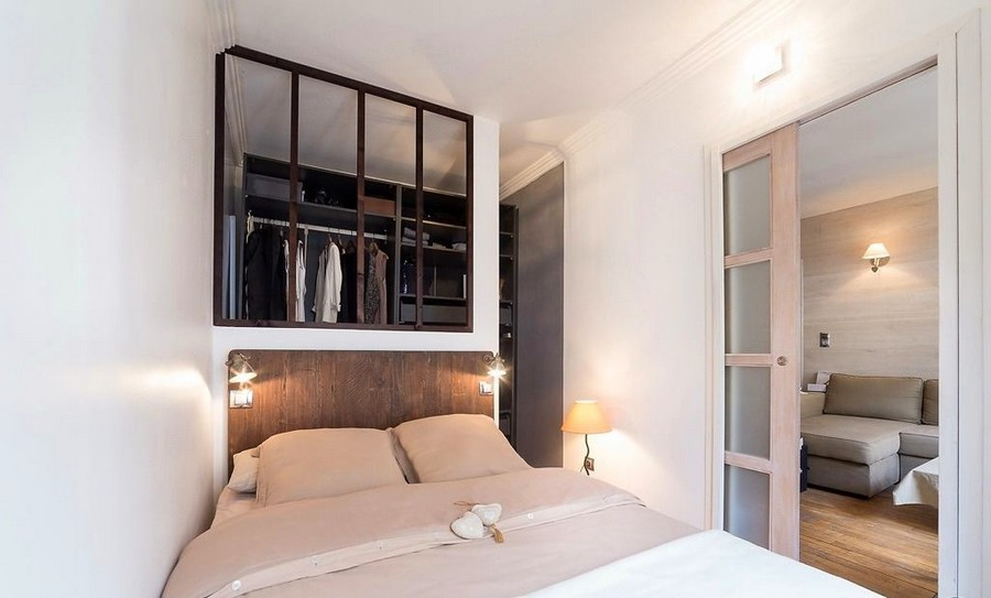 4-white-walls-beige-gray-caramel-brown-interior-design-in-French-style-Paris-bedroom-sleeping-area-glass-partition-walk-in-closet-lamps-sliding-door-wooden-headboard