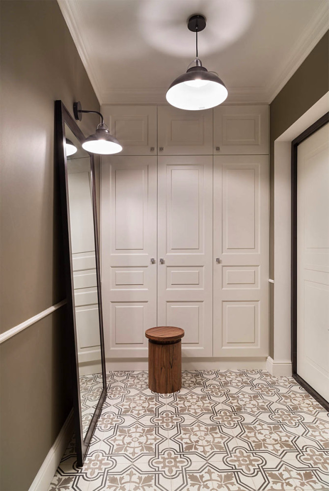 5-3-gray-and-white-interior-traditional-style-hallway-mudroom-corridor-entrance-hall-full-length-floor-standing-mirror-padded-stool-ottoman-white-built-in-closet-black-lamp