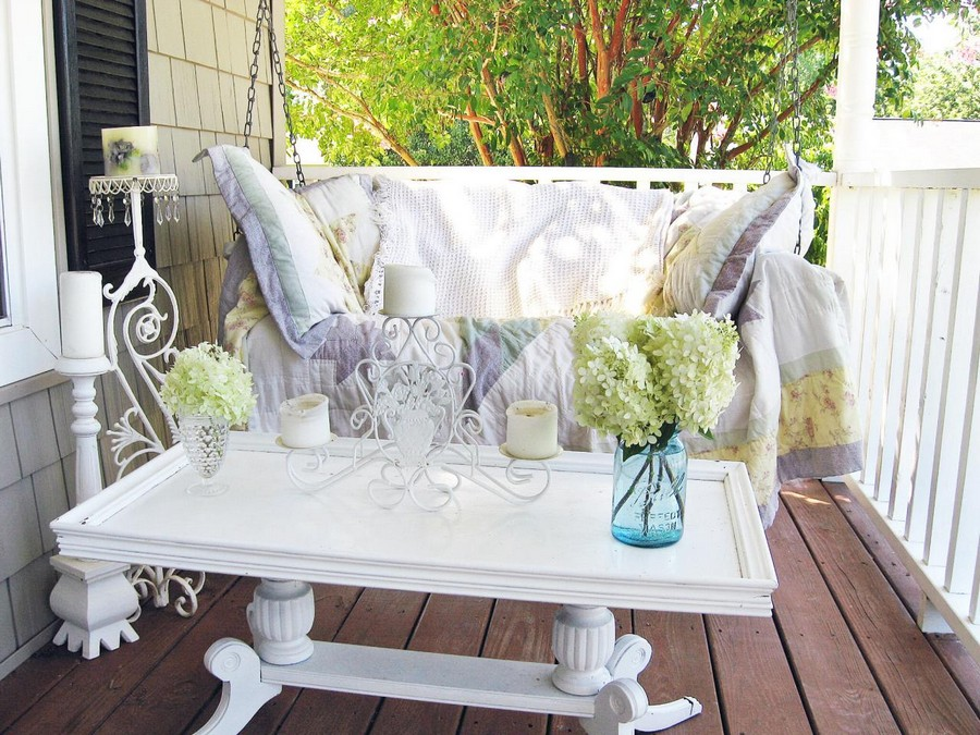 5-cozy-balcony-design-swing-seat-pillows-white-coffee-table-flowers-candlestick-candles-decking-floor
