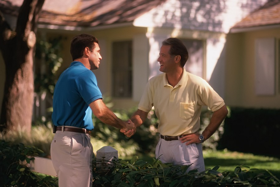 5-making-friends-with-neighbors-men-shaking-hands-over-a-hedge-good-relations