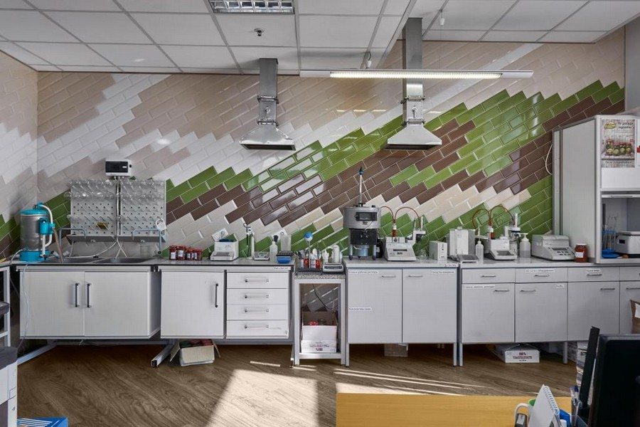 5-office-laboratory-interior-brick-wall-tiled-diagonal-pattern-multicolor-green-white-gray-testing-equipment