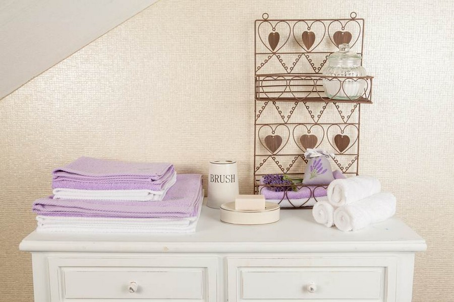 6-4-lilac-grey-color-in-interior-design-bathroom-bath-towels-white-chest-of-drawers-wrought-shelves-decor