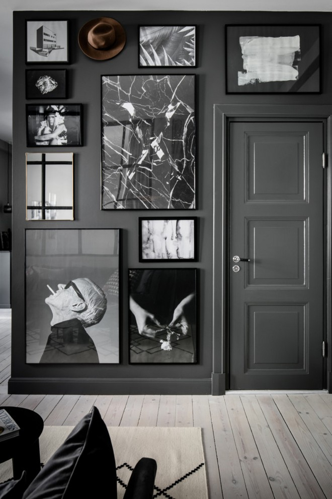 6-black-walls-black-walled-room-in-interior-design-mudroom-hallway-entrance-hall-room-black-and-white-wall-art-photo-gallery-wooden-floor