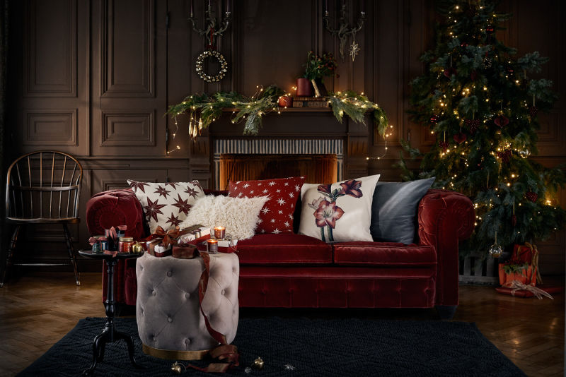 0-new-Christmas-2017-collection-of-home-decor-interior-design-by-H&M-Home-living-room-decoration-tree-red-velvet-sofa-ottoman-fireplace-dark-wall-panelling