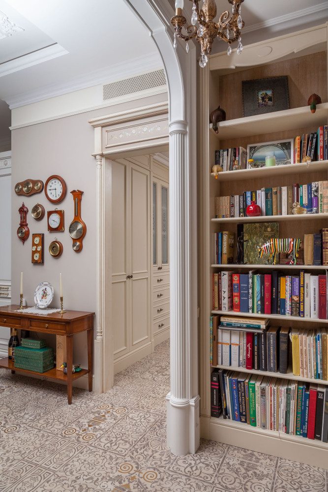 3-1-classical-elegant-English-style-interior-design-corridor-hallway-console-table-home-library-books-bookshelves-arched-doorway-floor-tiles-beige-brown-white