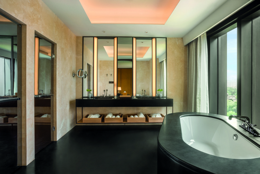 3-4-Bvlgari-hotel-beijing-luxurious-interior-design-China-bathroom-with-a-window-oval-bath-bathtub-double-sing-wash-basin