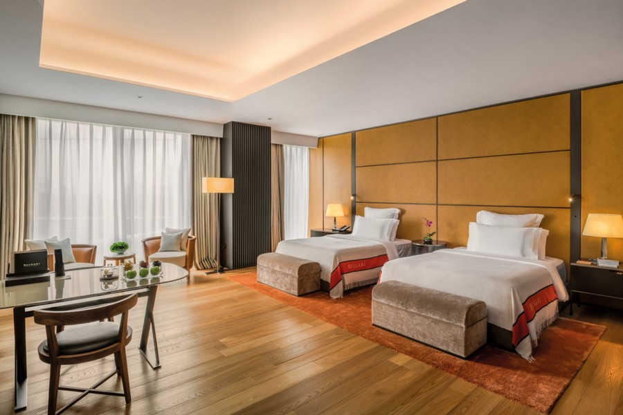 4-5-Bvlgari-hotel-beijing-luxurious-interior-design-China-double-room-single-beds-wooden-wall-decor-parquet-Italian-style-floor-lamp