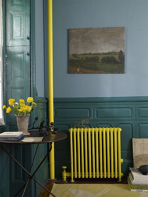 4-how-to-add-bright-color-to-home-interior-darl-blue-green-living-room-interior-yellow-radiator-cast-iron-coffee-table-wall-art