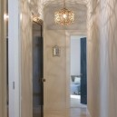 5-narrow-hallway-decoration-decor-interior-design-light-walls-light-floor-parquet-creative-fanciful-chandeliers-shadow-light