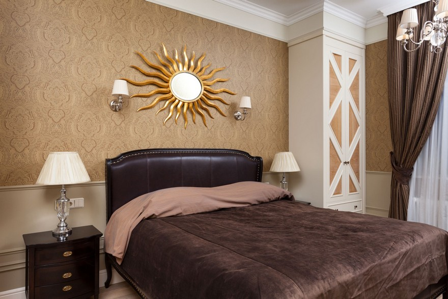 6-1-classical-elegant-English-style-interior-design-bedroom-brown-white-black-bed-headboard-curtains-bedside-lamps-nightstands-built-in-narrow-tall-closet-sun-mirror-sconce