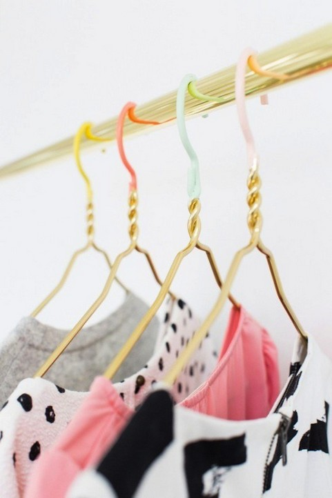 6-how-to-add-bright-color-to-home-interior-multicolor-yellow-pink-blue-coat-hangers-open-clothes-storage