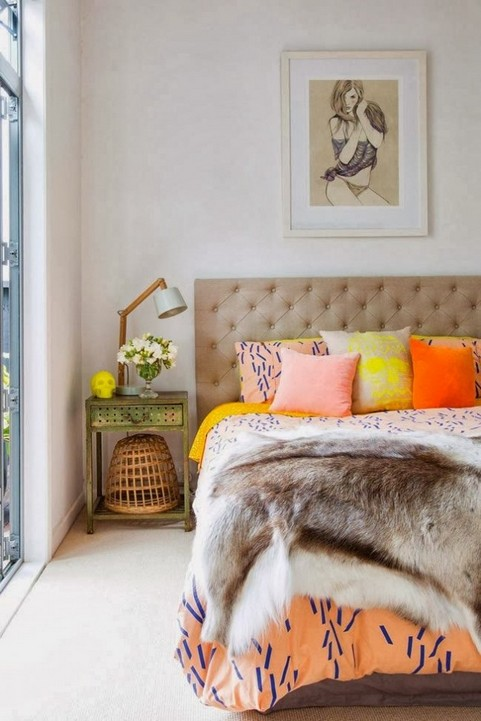 9-how-to-add-bright-color-to-home-interior-bedroom-decor-wall-art-beige-capitone-headboard-upholstered-bed-fur-blanket-ornage-yellow-pillows-metal-nightstand-lamp-sculp-flowers