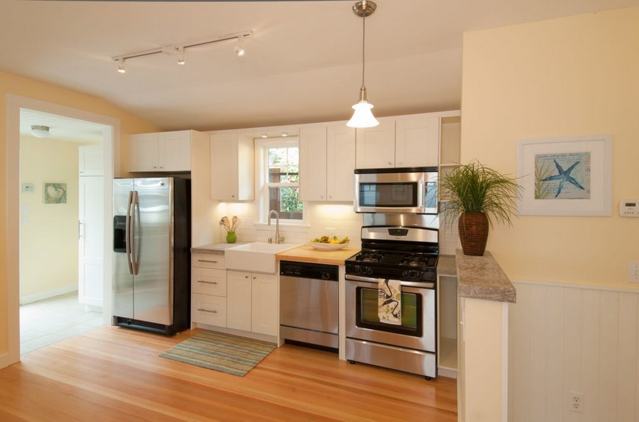 0-tidy-clean-clear-non-cluttered-kitchen-space-organization-refrigerator-sink-stove-small-countertop-white-cabinets