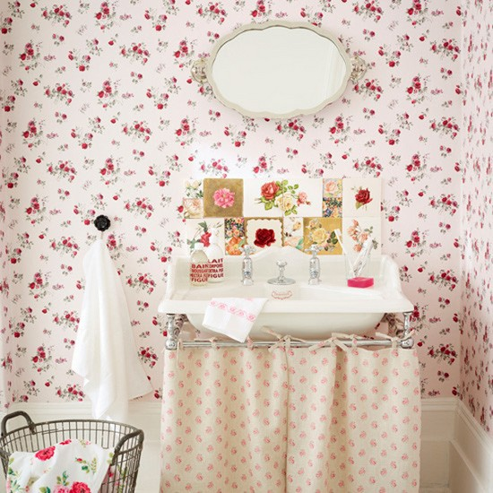1-vintage-retro-style-bathroom-interior-pink-red-floral-wallpaper-white-wall-panelling-sink-oval-mirror-tiles-laundry-basket-towel