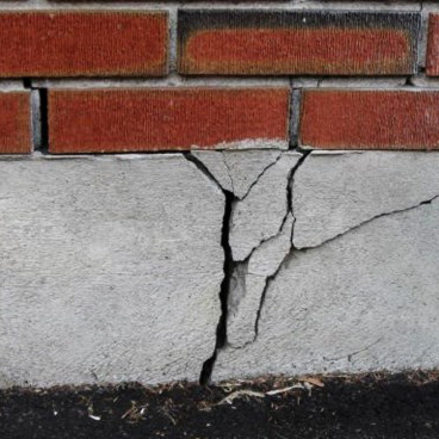 2-cracks-damage-in-brick-house-garage-foundation