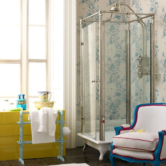 2-vintage-retro-style-bathroom-interior-blue-and-white-wall-tiles-shower-cabin-walk-in-yellow-chest-of-drawers-blue-towel-holder-arm-chair-big-window
