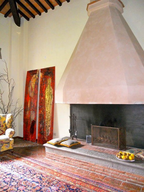1-6-wood-burning-fireplace-ideas-decoration-in-interior-design-concrete-finishing-in-ethnic-style-carpet-pillows-arm-chair