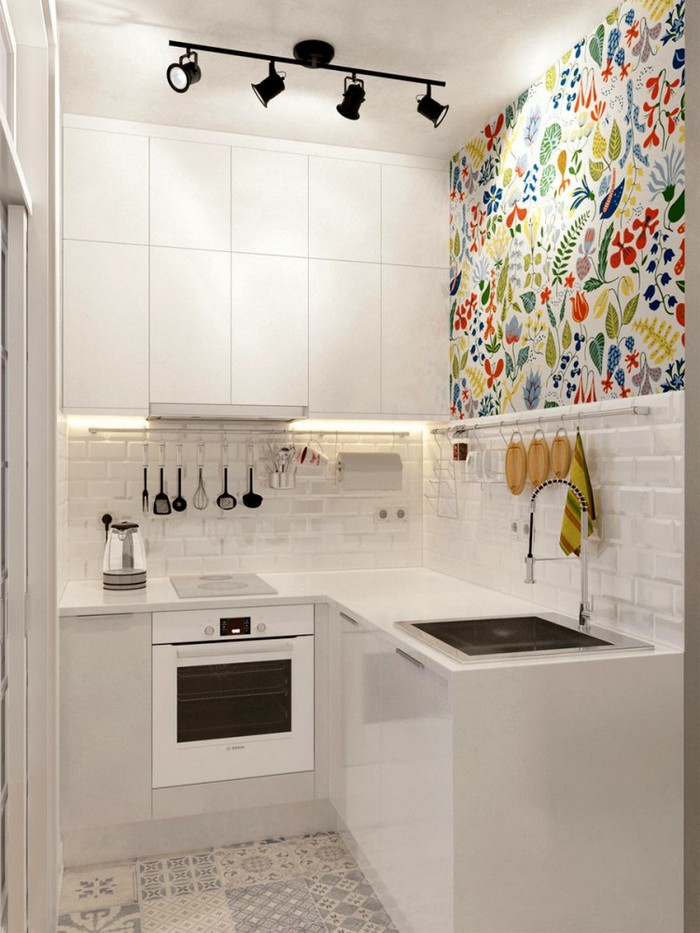 3-1-light-grayish-blue-studio-apartment-interior-design-in-modern-style-kitchen-white-top-cabinets-minimalism-floral-wall-tiles-L-shaped-set-beige-floor-tiles-white-backsplash