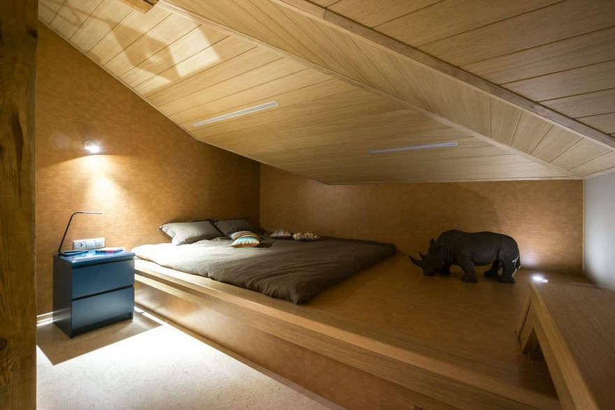 1-1-podium-bed-in-interior-design-teenage-boy-room-attic-floor-sloped-ceiling-asymmetrical-roof-wood-minimalist-style-blue-nightstand-gray-bed-linen