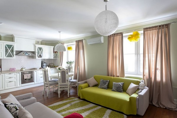 0-english-interior-style-open-concept-living-room-white-kitchen-green-sofa-ball-lamp-shaggy-rug-pastel-green-walls