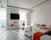 Snow-White Apartment with Orange and Red Accents