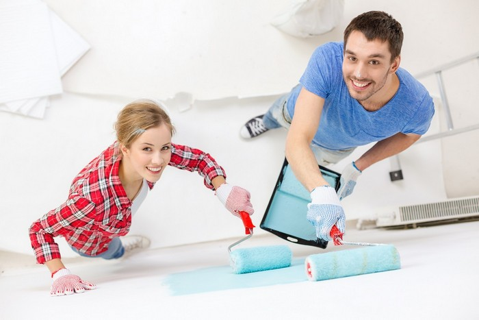 1-happy-family-couple-making-renovation-painting-walls