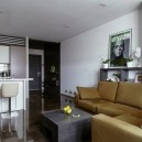 1-open-concept-living-room-kitchen-white-walls-concrete-polymeric-industrail-self-leveling-floor-espressi-sofa-couch